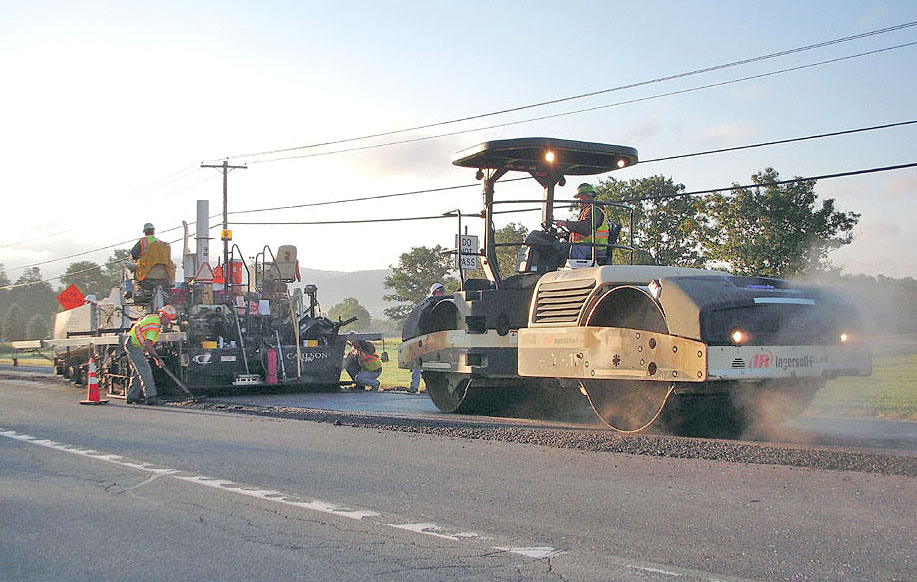 A Callanan crew led by Francis Grant lays down an experimental type of asphalt on Route 43 across from Dave's Market last Thursday. Photo by Pat Flint.