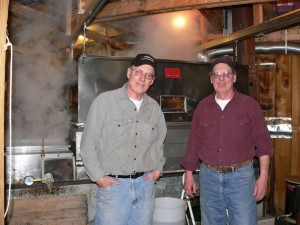 Walter and Dick Ogden, both retired, have cut their maple syrup boiling time to about three hours a day with the addition of a steamaway cover over the evaporator. (Bea Peterson photo)