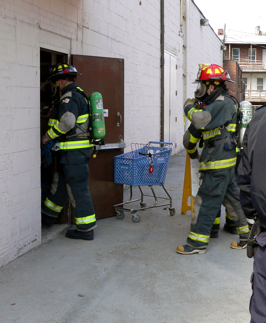 Hoosick Falls Firefighters entered the Rite Aid store wearing air packs to take readings on chemicals in the air in the building. (Bea Peterson photo)