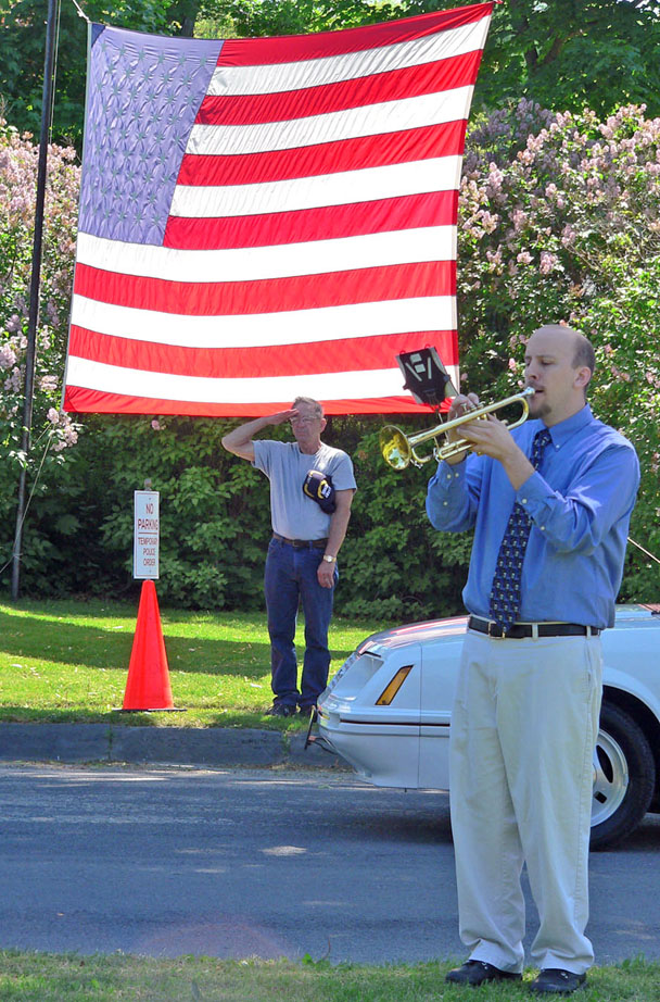 HFCS Band Director Robert Allen played taps as part of the Memorial Day ceremony at the intersection of Main and Church Streets, near the cemeteries. (Bea Peterson photo)