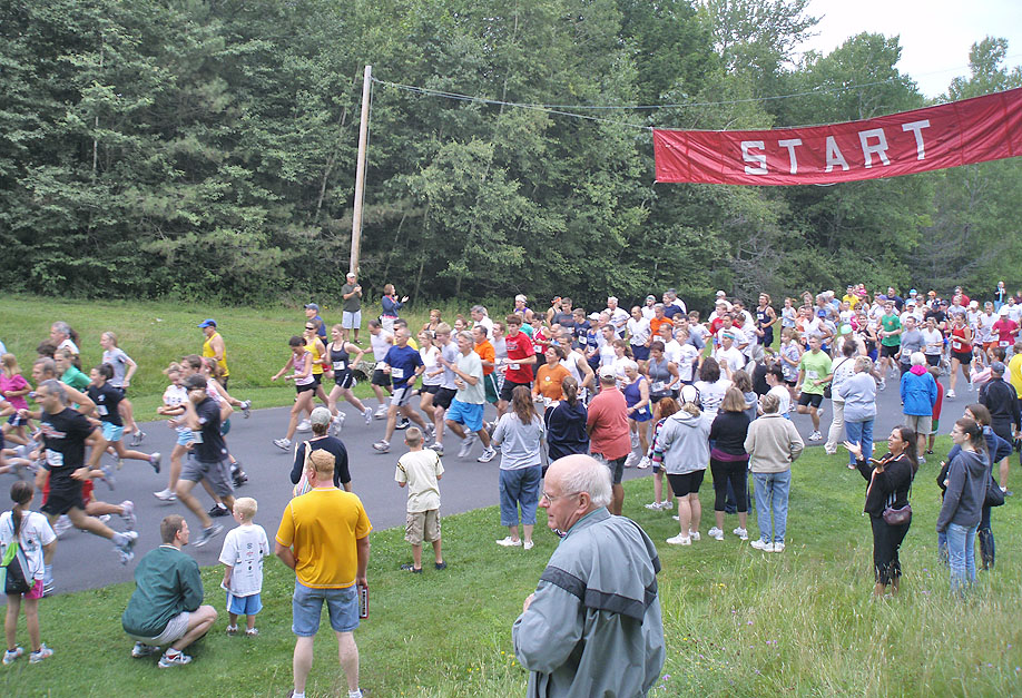 209 runners took off from the starting line at the Grafton Lakes State Park 24th Annual Run for the Roses on Sunday, August 9. Photos courtesy of Liz Wagner.
