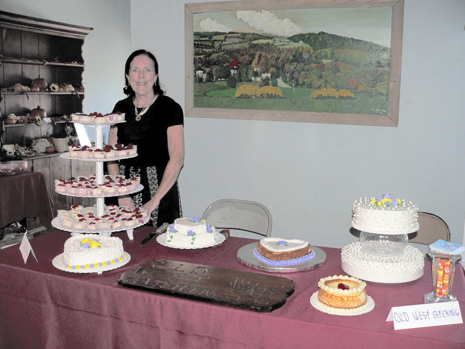 Hoosick Town Supervisor Marilyn Douglas stands behind the display of desserts created by Sue Landry's Old West Catering Co. at the Taste of Hoosick. (Bea Peterson photo)