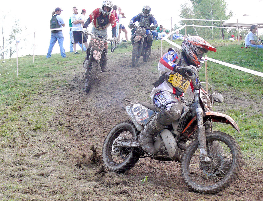 Three riders negotiate the muddy motorcycle track on Clay Hill Road last Sunday during the New England Trail Riders Association motorcycle competition. Photo by Steve Bradley.