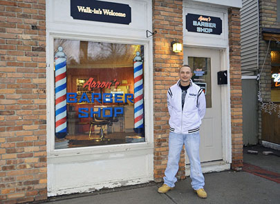 Aaron Schwab stands outside the new location of his barber shop at the ...