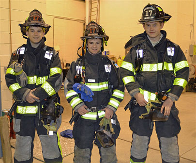 Junior firefighters Colby Davendonis, Mike Matatt and Charles Hodge were suited up and ready to go through the simulated exercises with NYS Fire Prevention Instructors Monday evening. (Bea Peterson photo)
