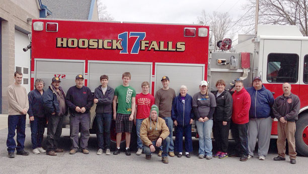 "Members of the Hoosick Falls Volunteer Fire Department gathered recently at the firehouse to prepare for the upcoming ""Recruit NY"" weekend. The Department, along with other departments across the State, will be hosting an open house on Saturday, April 27, from 11 am to 4 pm in efforts to recruit volunteers. The public will be welcome to view the firehouse in an attempt to gain interest of local residents to join the Department. This is the third year such an event has taken place, and the Department is looking forward to welcoming new volunteers. Photo courtesy of  Stacy Flynn."