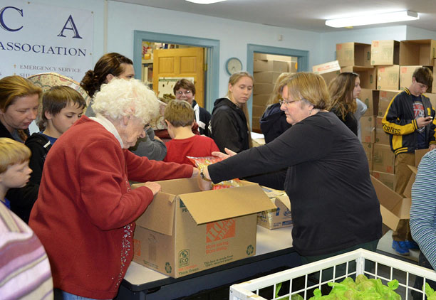 More than 40 volunteers packed Thanksgiving boxes at the HACA Food Pantry last Friday evening. (Bea Peterson photo)