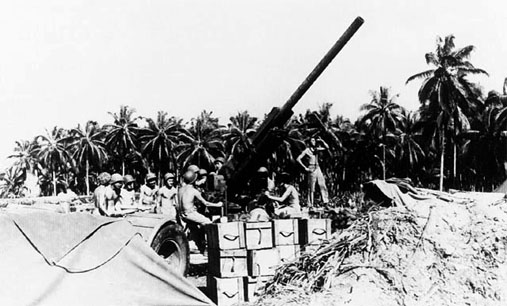 Marines in the Pacific manning a 90 mm antiaircraft gun like the one that William Halleck  of Stephentown manned on Guam in the Marianas in July, 1944. Department of Defense photo [USMC] 60625.