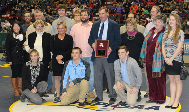 High School Wrestling Coach Jim Sutton, surrounded by his family, was recently inducted into the NYS High School Wrestling Hall of Fame. photo courtesy of Gerry Surdam