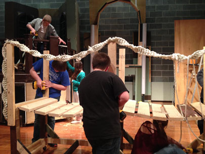 Crew members work on one of the many set pieces required for Shrek The Musical. Photo courtesy of Rob Allen