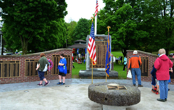 After the Hoosick Falls Memorial Day Parade and program, folks gathered at the Memorial Wall to find names of family members who have served in the various wars and conflicts over the years. (Bea Peterson photo)