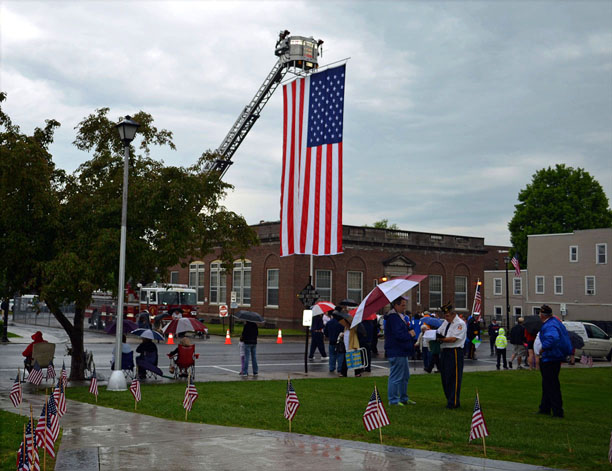 The Hoosick Falls Fire Department displayed its large American flag at the start of the Memorial Day Parade on Monday. (Bea Peterson photo)