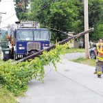 Garbage Truck Gets Hung Up In Wires
